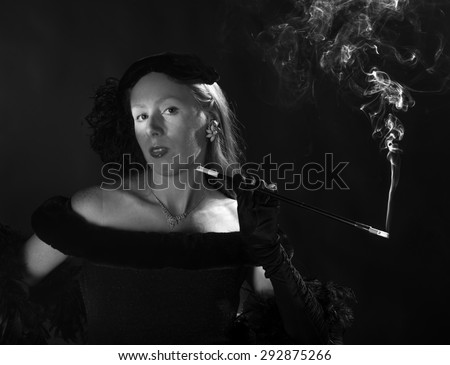 Elegant Black and White Portrait of Glamorous Woman Smoking Cigarette and Dressed in Vintage Clothing, Waist Up Portrait in 1940s Film Noir Style - stock photo