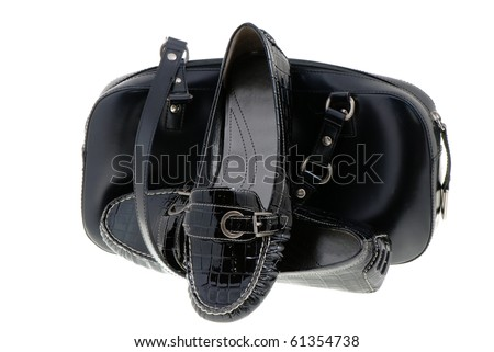 elegant black lady's shoes and bag  over white