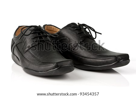 Elegant black leather men's shoes on white background with shadow.