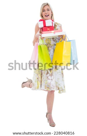 Elegant blonde with shopping bags and giftson white background