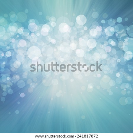 elegant blue background, white bokeh lights shine in center layer on blurred zoom effect background, shiny glittering silver white balls of light with bright center and sky blue hue border - stock photo