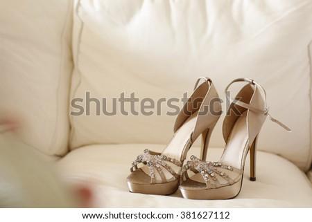 Elegant bride's shoes - stock photo