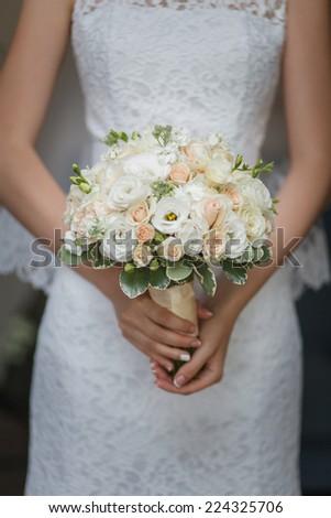Elegant bride with a bouquet - stock photo