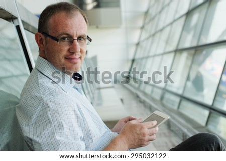 elegant business man with tablet - stock photo