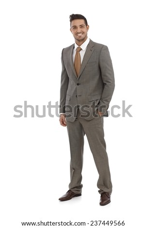 Elegant businessman smiling in grey suit over white background. - stock photo