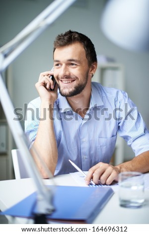 Elegant businessman speaking on the phone - stock photo