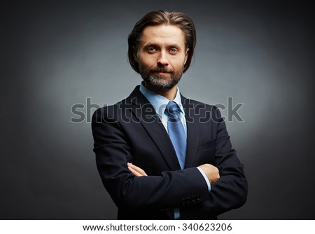 Elegant businessman with crossed arms looking at camera