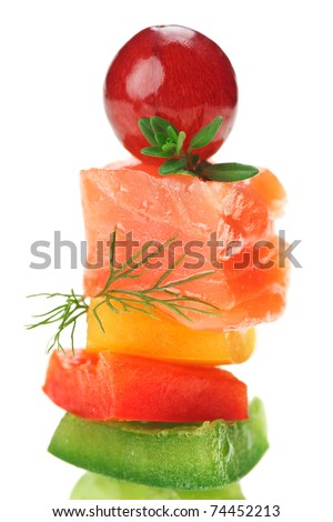 Elegant canape with salmon fish, dill twig, thyme and grape isolated on white