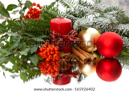 Elegant christmas decoration, baubles and candle on mirror - stock photo