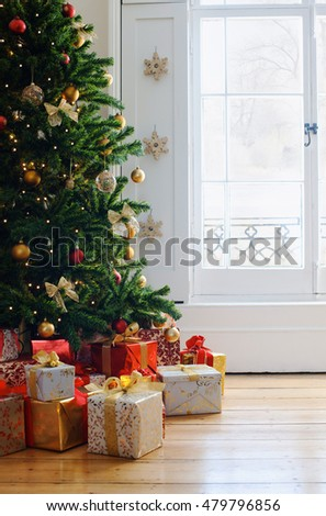 Elegant christmas tree with decorations and gifts