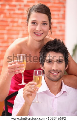 Elegant couple drinking champagne - stock photo