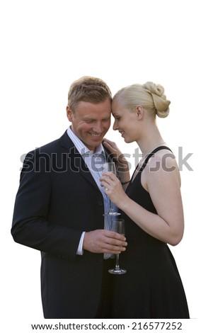 Elegant couple drinking champagne together - stock photo