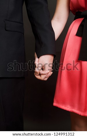 Elegant couple  holding by hands valentines day - stock photo