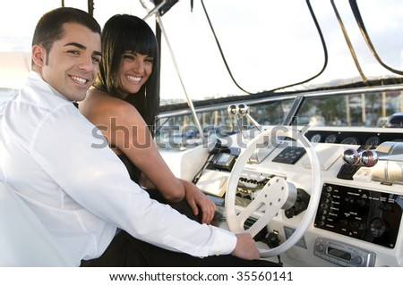 elegant couple in a yacht laughing - stock photo
