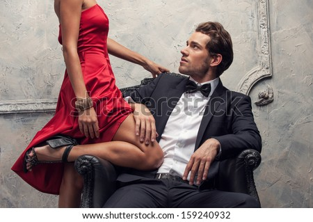 Elegant couple passing in classic clothes. Close up, cut shoot  - stock photo