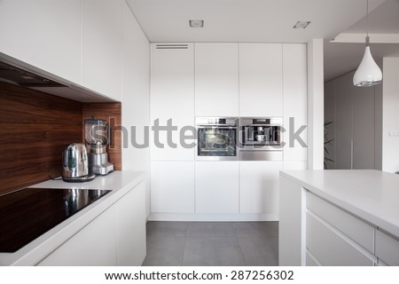 Elegant cozy kitchen with white units and marble floor