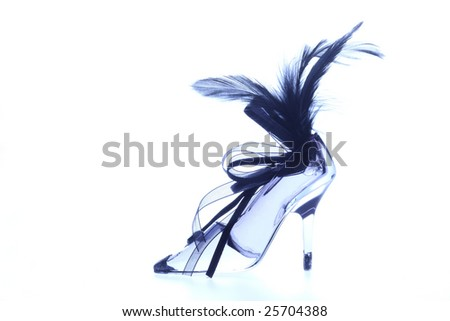 Elegant crystal shoe on a white background - stock photo