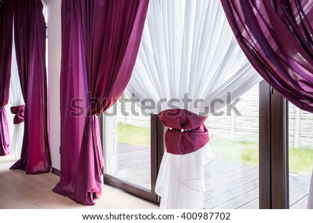 Elegant curtain and purple drapes in luxury residence - stock photo