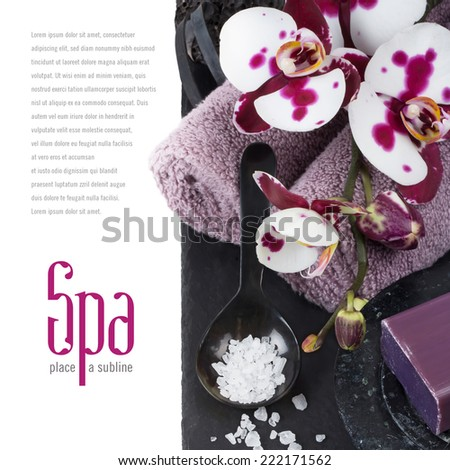 elegant dark spa concept/background with towels, soap, bath salt and orchid flowers - stock photo