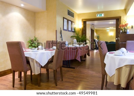 Elegant decorated dining room (Empty restaurant with set tables) - stock photo
