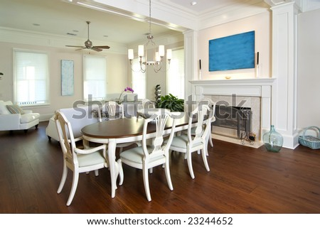 elegant diningroom and livingroom with fireplace - stock photo