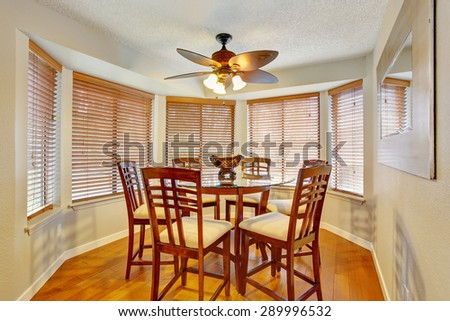 Elegant dinning room with hardwood floor and lots of windows.