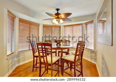 Elegant dinning room with hardwood floor and lots of windows. - stock photo