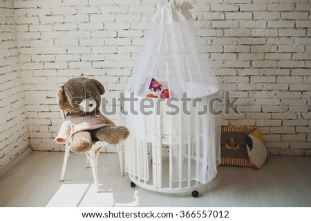 Elegant expensive bed for newborn baby. Luxury decorations of apartments - stock photo