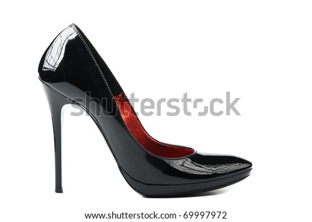 Elegant expensive black high heel women shoes on white background - fetish female weapon - stock photo