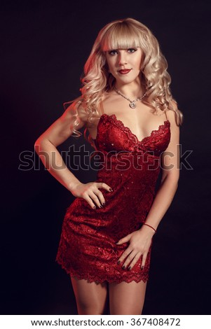 Elegant fashion photo of glamor beautiful blonde-haired woman in sexy dress with gold jewelry and posing in the studio,luxury