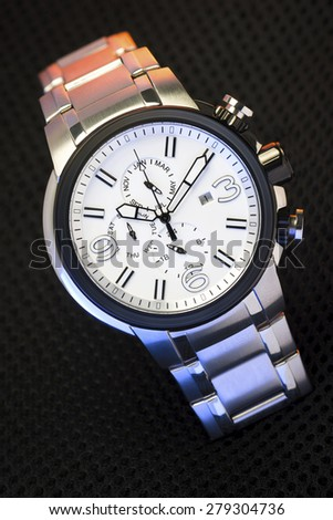 Elegant Fashion Wristwatch on Black Textured Fabric - stock photo