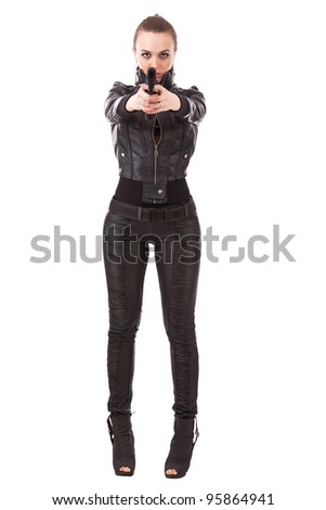 Elegant fashionable girl with a gun in hands - stock photo