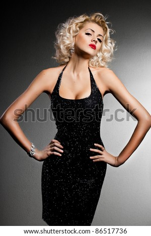 elegant fashionable woman in black dress - stock photo