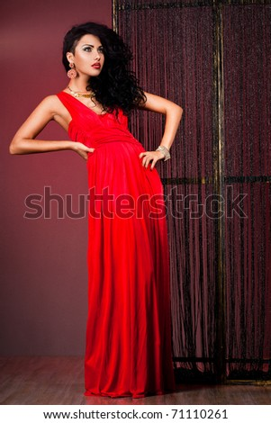 elegant fashionable woman in red dress
