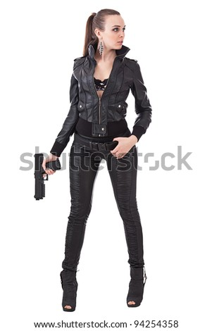 Elegant fashionable woman with a gun in hands - stock photo