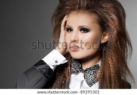 elegant fashionable woman with bow-tie - stock photo