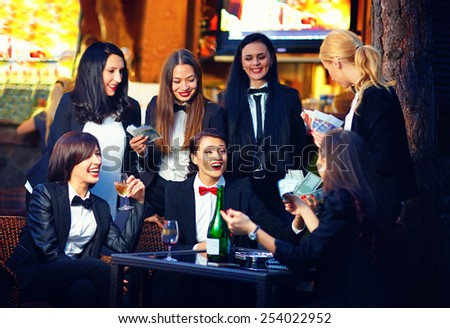 elegant fashionable women gambling in night club - stock photo