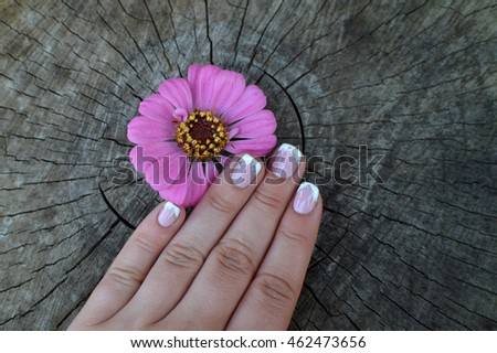 Elegant female hands with manicure on the nails.