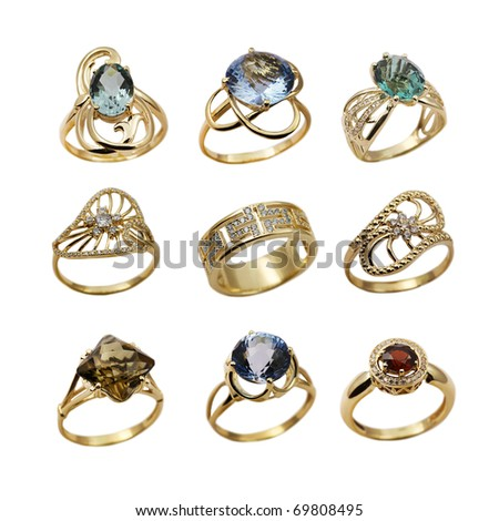 Elegant female jewelry golden  rings  isolated over white - stock photo