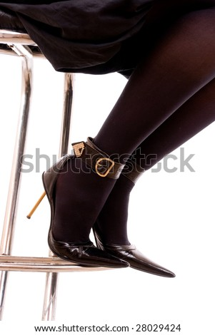 Elegant female legs in black stockings and classical shoes on a heel - stock photo