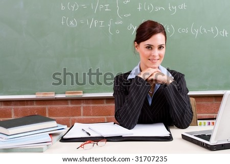 elegant female school teacher in classroom