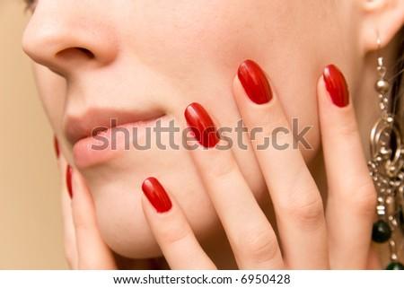 Elegant fingers on woman face. - stock photo