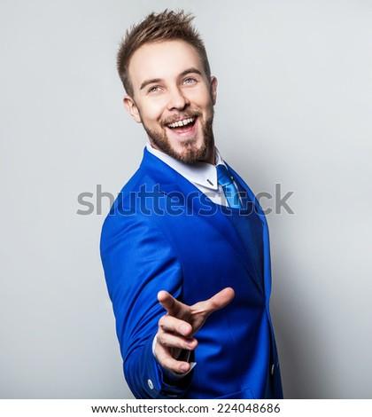 Elegant & friendly young handsome man in fashionable costume. Studio man portrait. - stock photo