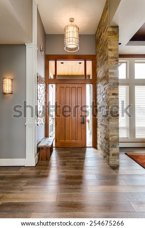 Elegant  Front Door and Entry in New Luxury Home - stock photo