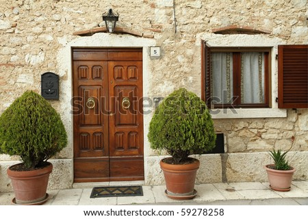elegant front door, Tuscany - stock photo