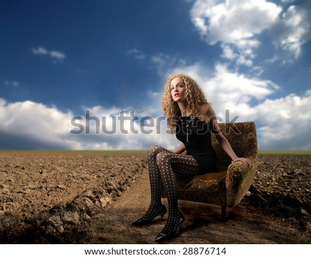 elegant girl lost in the country - stock photo