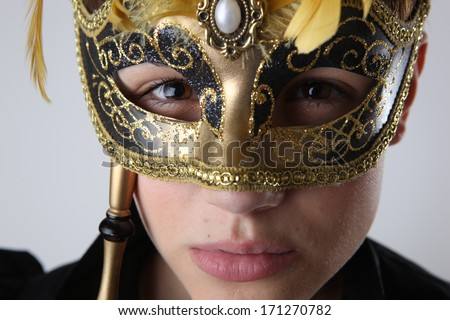 Elegant girl with a wonderful mask studio shot