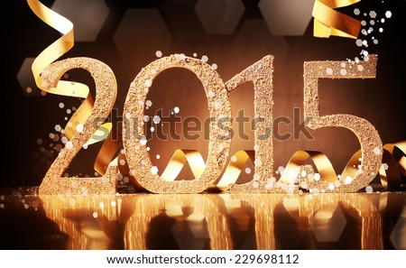 Elegant gold 2015 New Year background with textured golden numbers and twirled gold ribbon on a reflective dark brown surface for your seasonal greeting or invitation - stock photo