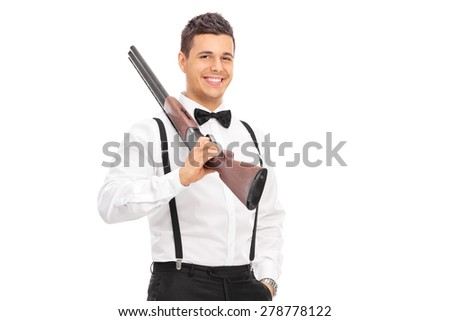 Elegant guy holding a shotgun over his shoulder isolated on white background - stock photo