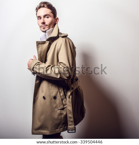 Elegant handsome man in stylish coat. - stock photo
